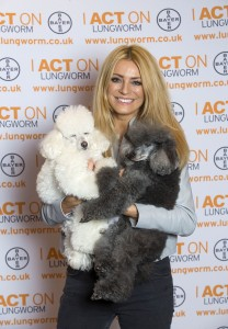 EDITORIAL USE ONLY Tess Daly meets Poodles Troy and Cedric, at Crufts at the NEC in Birmingham to support the Be Lungworm Aware campaign and raise awareness of the lungworm parasite, which can be fatal to dogs. PRESS ASSOCIATION Photo. Picture date: Thursday March 10, 2016. The life-threatening lungworm parasite (Angiostrongylus vasorum) is carried by slugs and snails and can be found in slug slime. If a dog accidentally swallows one of these common garden creatures, there is a risk it could become infected, causes symptoms such as breathing difficulties, excessive bleeding, vomiting and, in some cases, death. Tess and her vet believe that her golden retriever, Sam, died of lungworm. Photo credit should read: Fabio De Paola/PA Wire