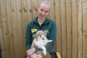 Photo 4 - Trudy is pictured have a cuddle with Canine Carer Kerianne Thomasson.
