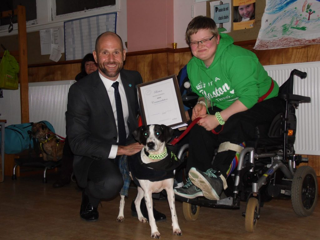 Owner Nicola Russel and Boston with his PDSA Commendation, which was presented by PDSA Vet john Faulkner