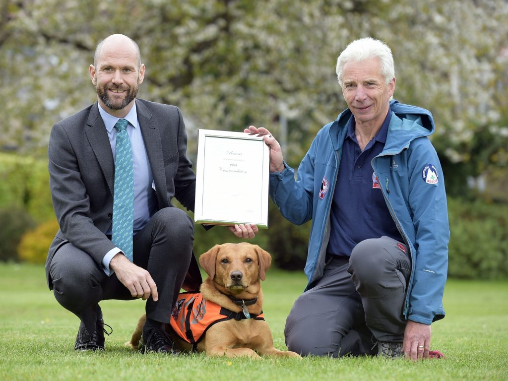 PIC © Sandy Young 07970 268944 Scottish search dog honoured. Rauour (3 year old Labrador) receives PDSA commendation for devotion to duty. Pictured L-R and PDSA Vet, John Faulkner, Rauour and handler John Romanes  A three-year-old Labrador from Selkirk is being honoured by vet charity PDSA after successfully finding a critically injured missing woman in blizzard conditions. Auburn-haired Search and Rescue dog Rauour Ð which means ÔredÕ in Icelandic Ð was presented with his PDSA Commendation by the charityÕs Vet Surgeon, John Faulkner, at the Tweed Valley Mountain Rescue TeamÕs Melrose base this week.   www.scottishphotographer.com sandyyoungphotography.wordpress.com sj.young@virgin.net 07970 268 944