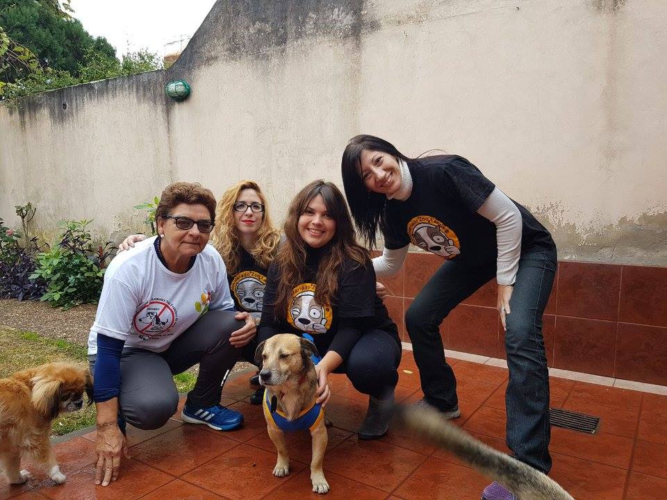 Petro pictured with volunteers and his new owner