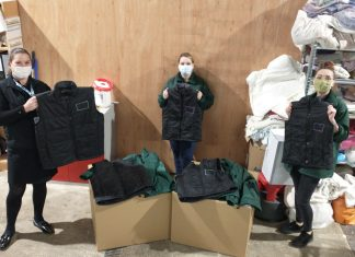 DOTS volunteers with supplies for the homeless