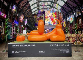 orange balloon dog in playful bow
